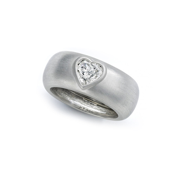 Gravity ring with heart-shaped diamond.