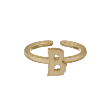 Mid-finger letter ring in gold.