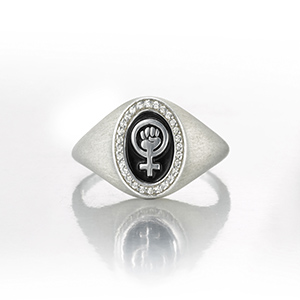Signet ring with Venus symbol and fist of resistance.