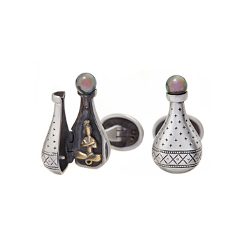 Genie in a Bottle cufflinks, shown with one link open and one closed.