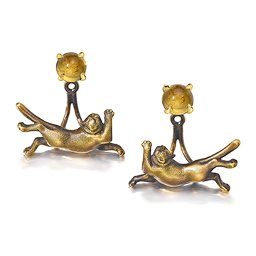 FitzRoy the cat earring jackets with citrine birthstone studs.